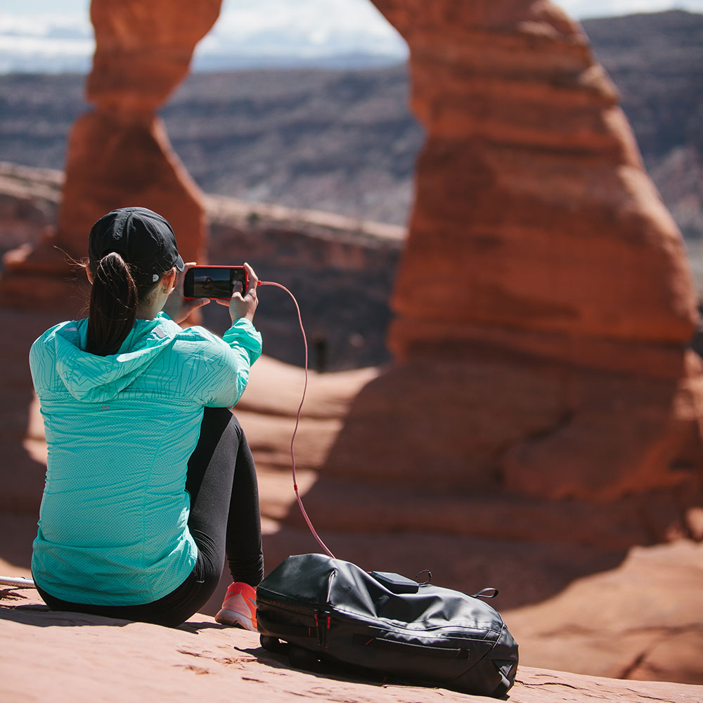 Lander Powell case with Cascade powerbank Neve lightning cable and Timp 20L backpack at arches national park