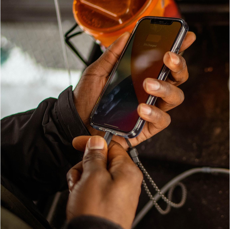 Man chargin phone with Glacier Case