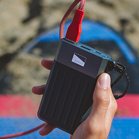 Lander cascade 7800mAh powerbank with Neve lightning cable on the beach