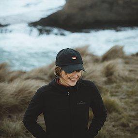 Lander emblem hat at the ocean